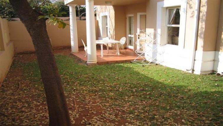 Inviting garden in Villa Via Apartments