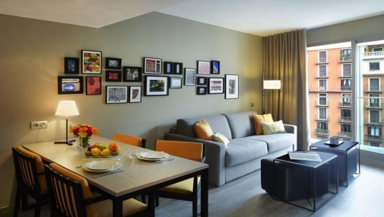 Comfortable living area in Citadines Ramblas Apartments