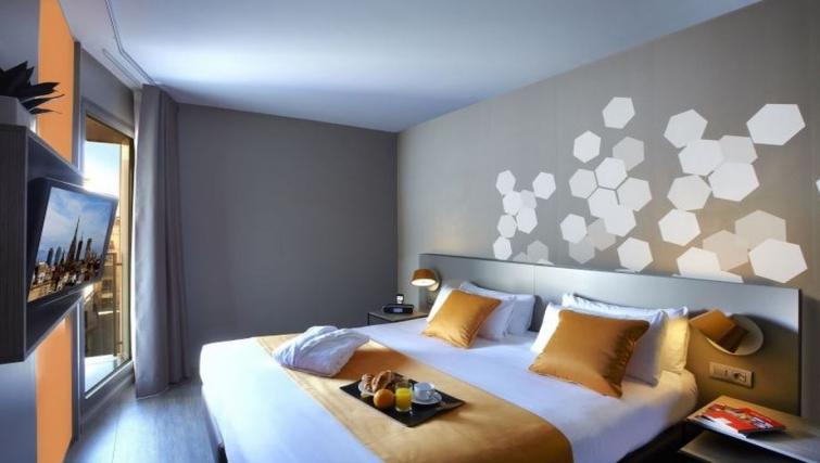 Cosy bedroom in Citadines Ramblas Apartments