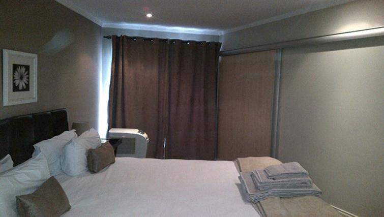Calming bedroom in Sandhurst Towers Apartments