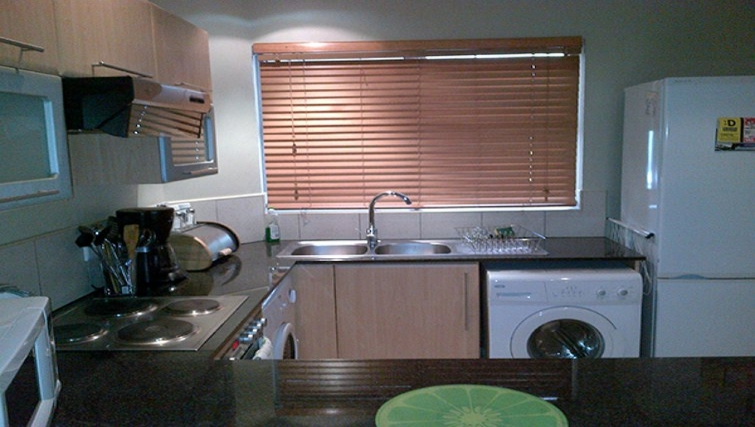 Well equipped kitchen in Sandhurst Towers Apartments