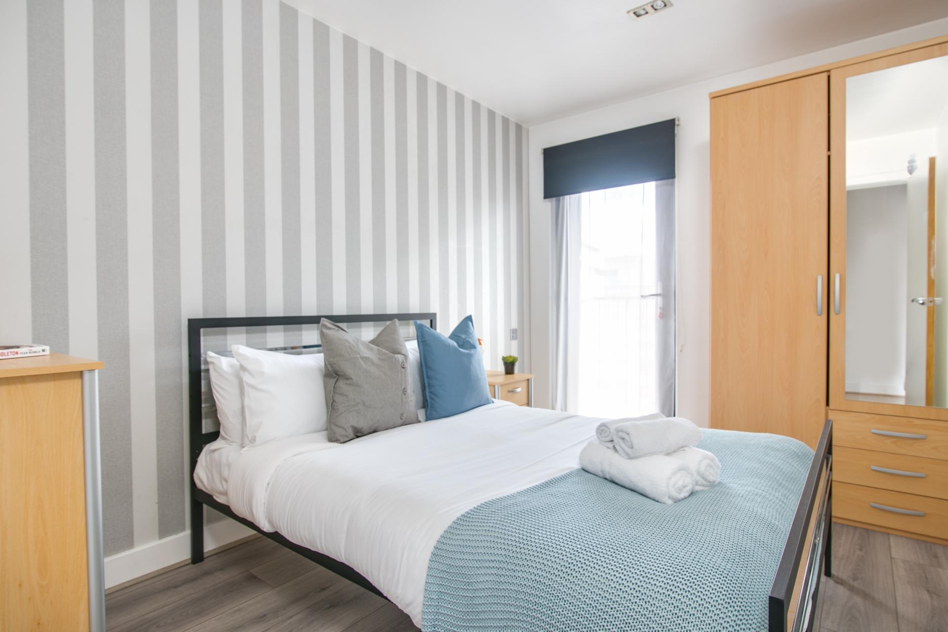 Light bedroom at Canal Muse Apartment, Newtown, Birmingham