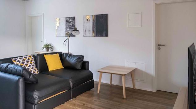 Living Room at Schweizersbildstrasse Apartments