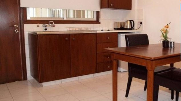 Functional kitchen in Petrou Aparthotel