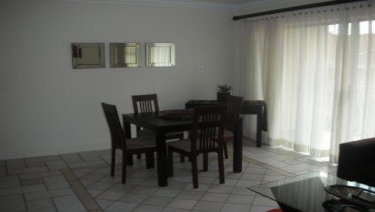 Functional dining area in Northernacres Apartments