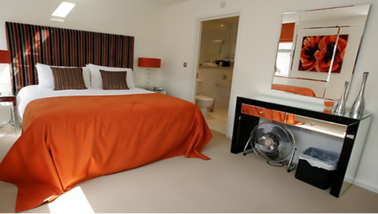 Colourful bedroom in Chelmsford Serviced Apartments
