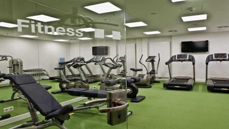 Modern gym at Adina Apartment Hotel Berlin Hackescher Markt