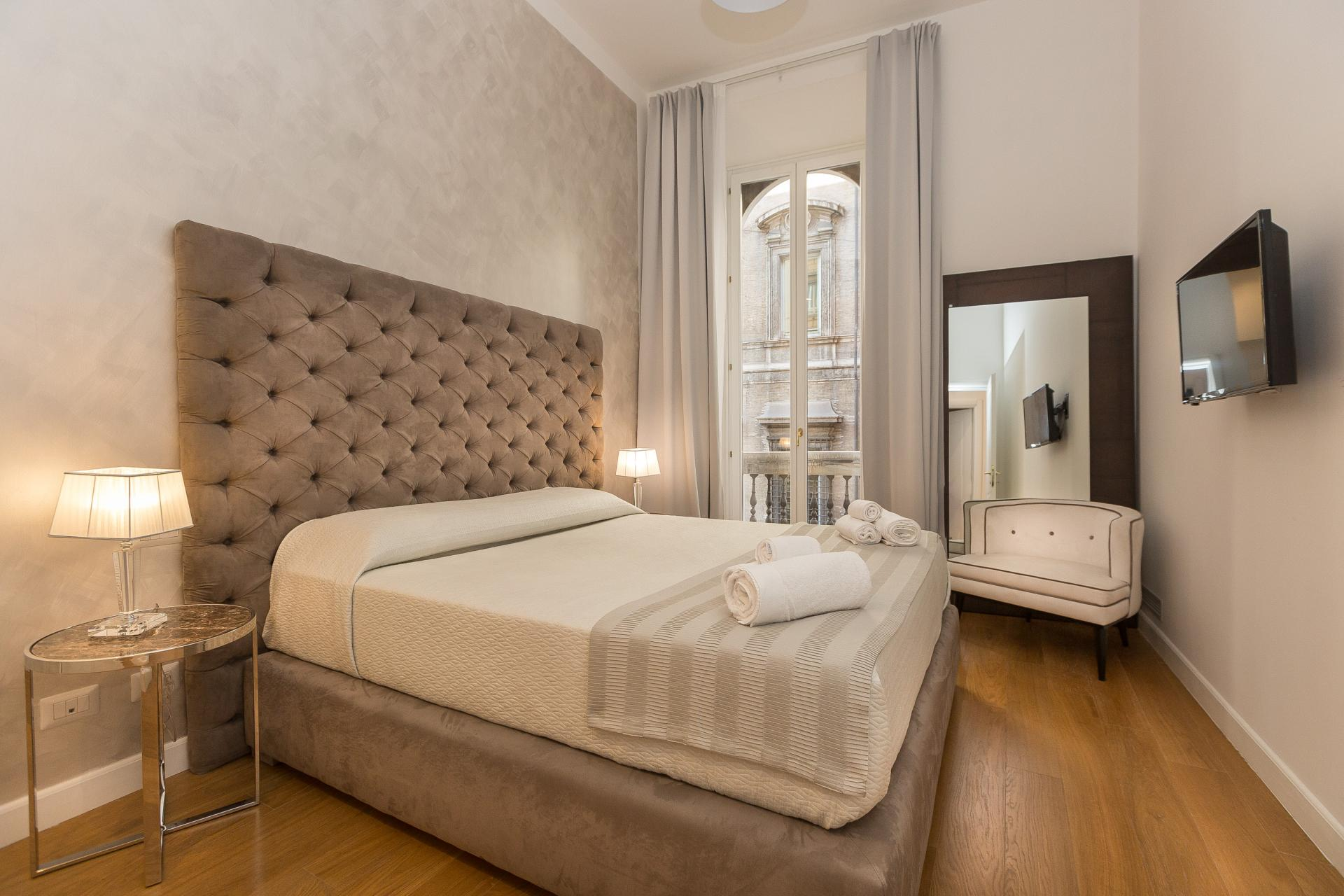Bright bedroom at Velvet Vittoriano Apartment, Municipio I, Rome