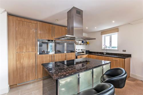 Kitchen island at Chester Racecourse Apartments