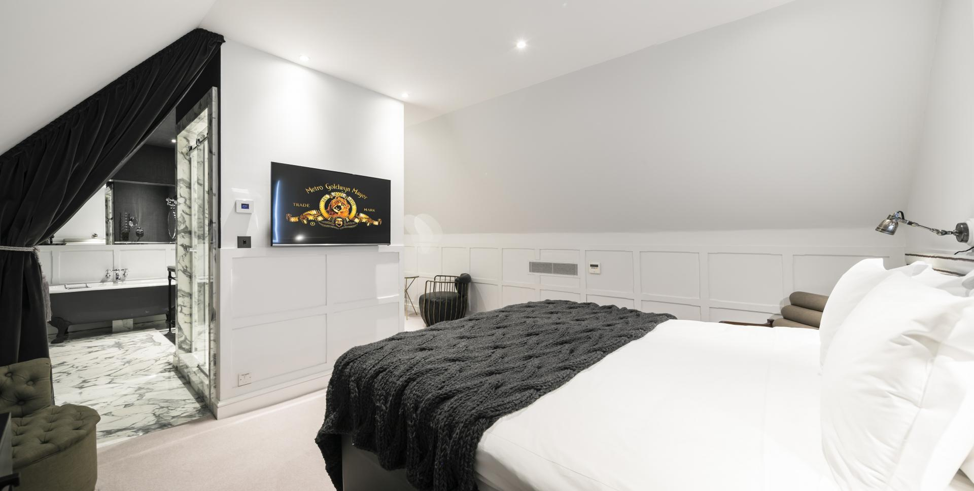 Tv in bedroom at Luxurious Mayfair Apartments, Mayfair, London