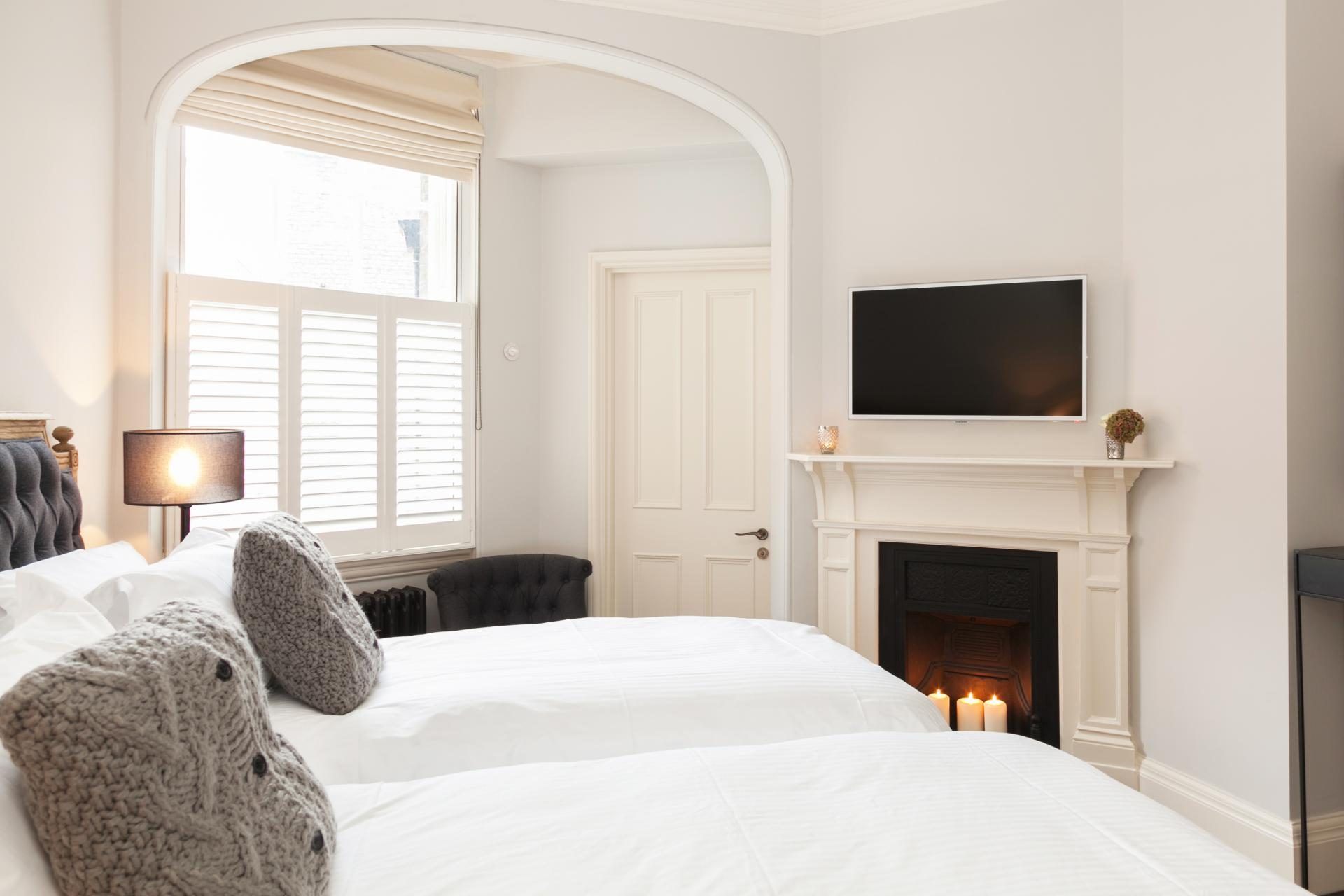 Fireplace in bedroom at Luxurious Mayfair Apartments, Mayfair, London