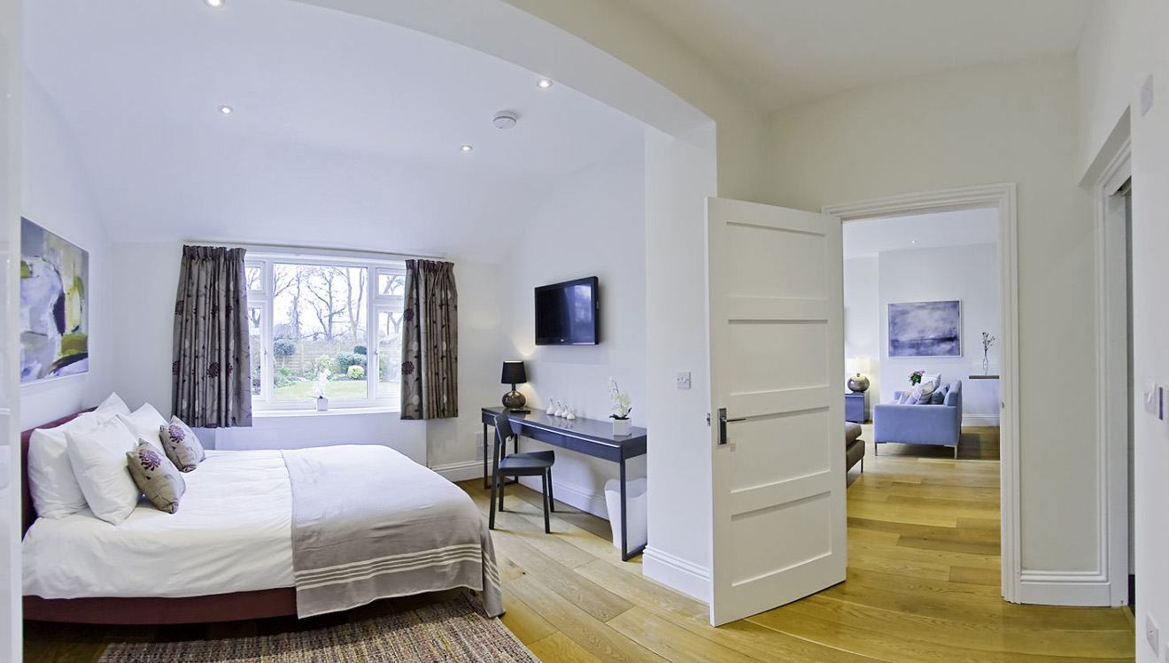 Bright bedroom at Craven House Apartments
