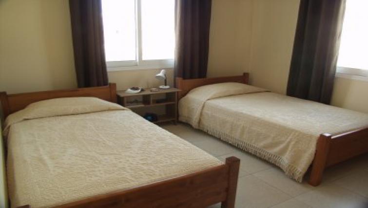 Simplistic bedroom in Pyla Village Apartment
