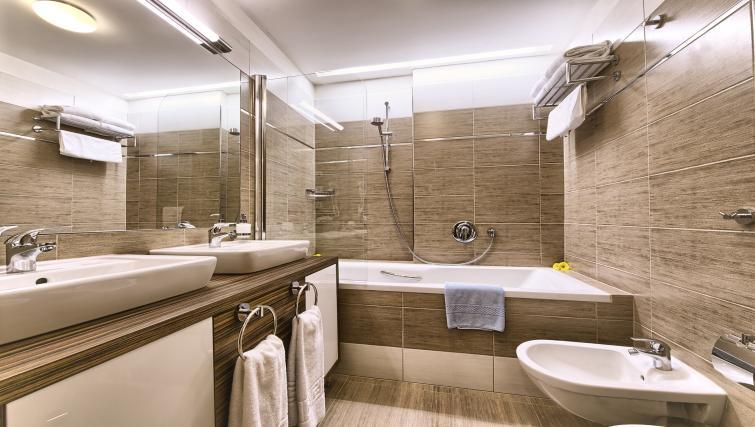 Stylish bathroom at Residence Brehova Apartments
