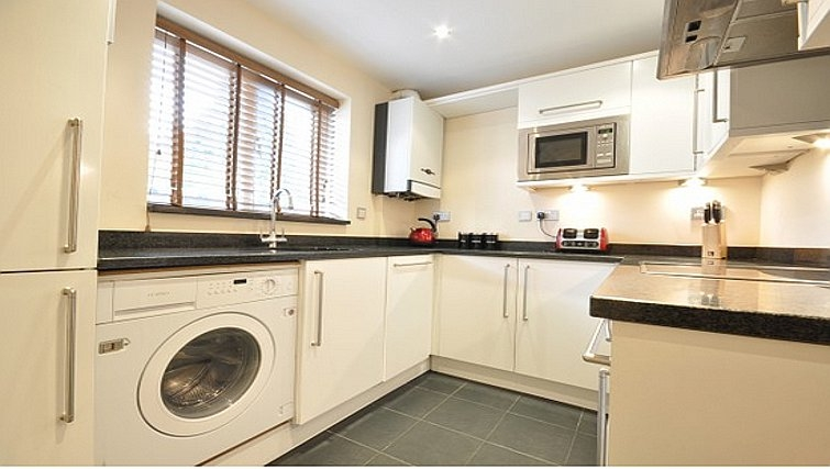 Crisp kitchen in Lower Road Apartments