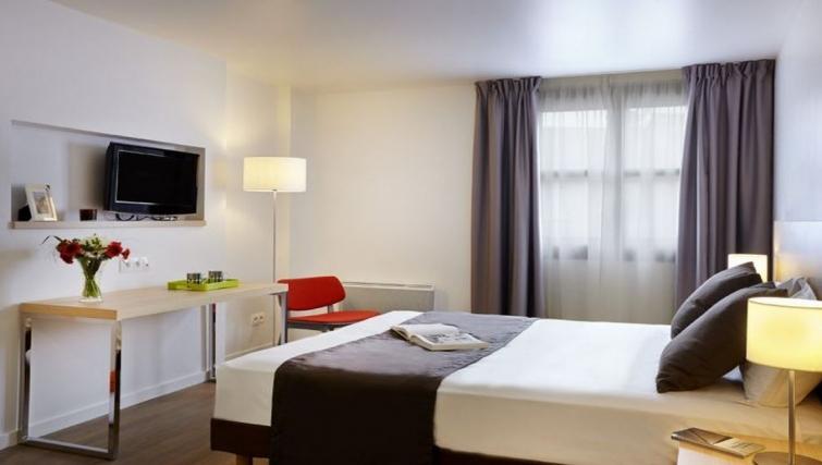 Comfortable living area in Citadines Presqu'ile Apartments