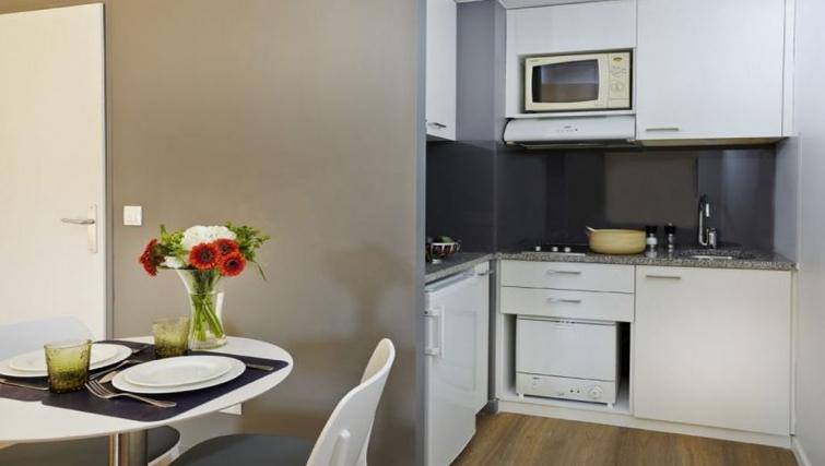 Modest kitchen in Citadines Presqu'ile Apartments