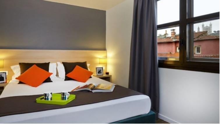 Charming bedroom in Citadines Presqu'ile Apartments