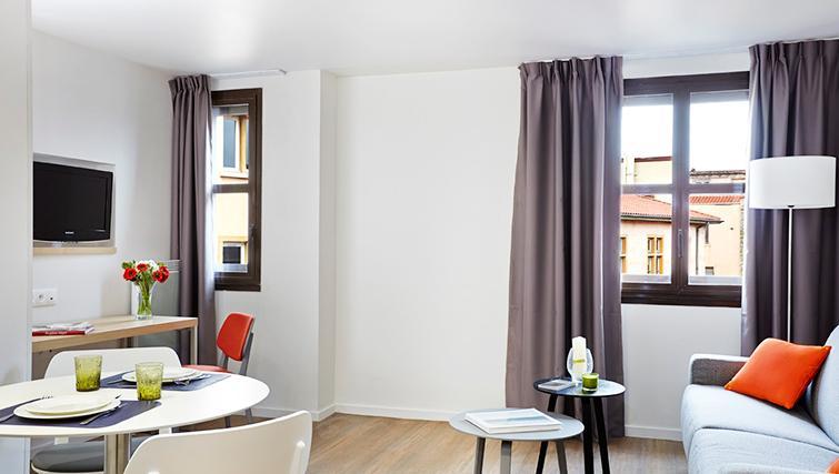 Living area at Citadines Presqu'ile Apartments