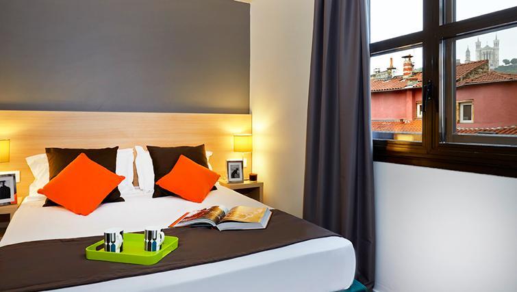 Bedroom at Citadines Presqu'ile Apartments