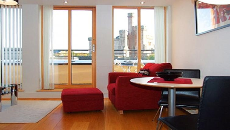 Lovely living area in By the Bridge Apartments
