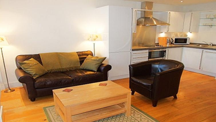 Stylish living area in By the Bridge Apartments