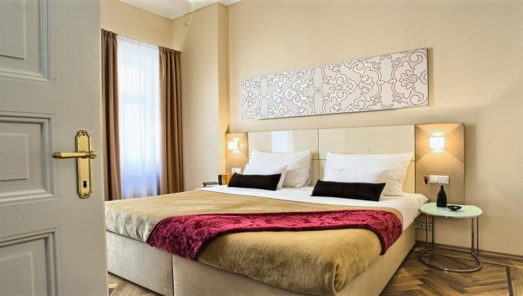 Comfy bed at Residence Karolina Apartments