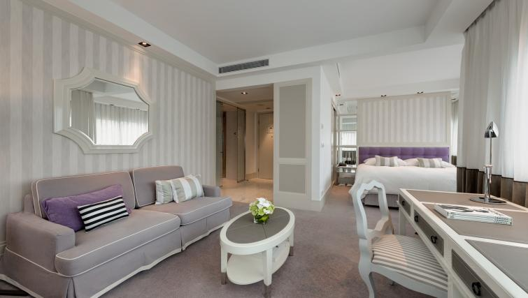 Spacious living area at Lanson Place Hotel and Apartments