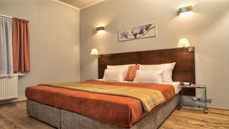 Bed at Residence Rybna Apartments
