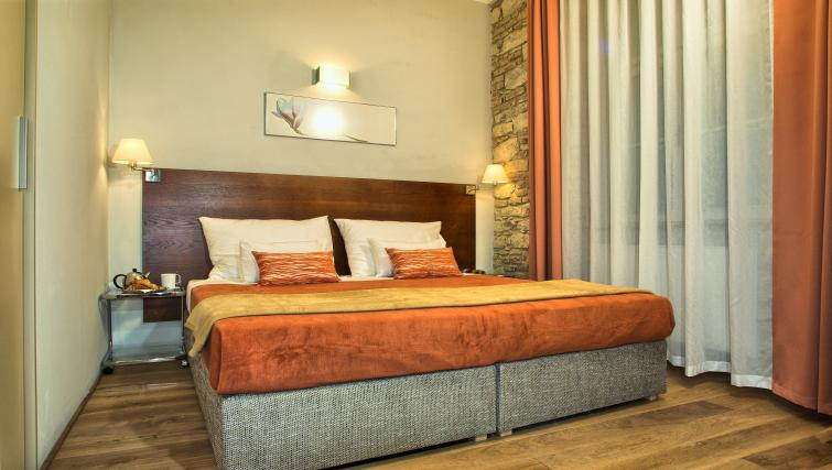 Bright bedroom at Residence Rybna Apartments