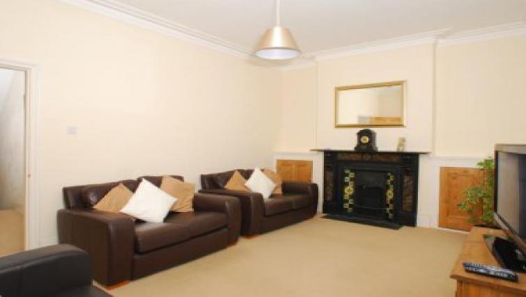 Tasteful living area in Molesworth Apartment
