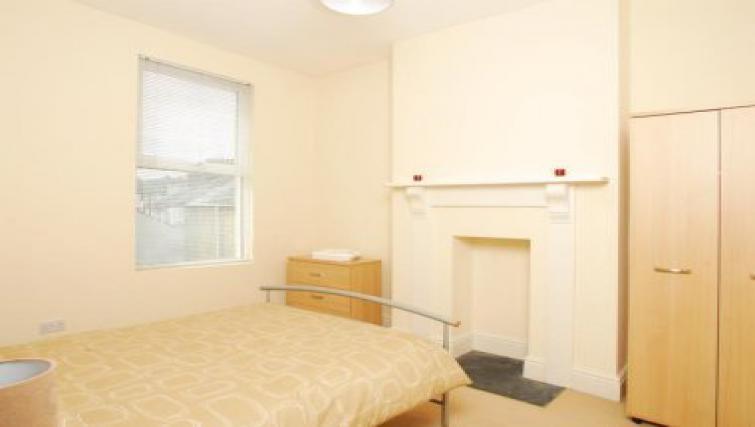 Serene bedroom in Molesworth Apartment