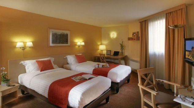 Stylish bedroom in Citadines Wilson Apartments