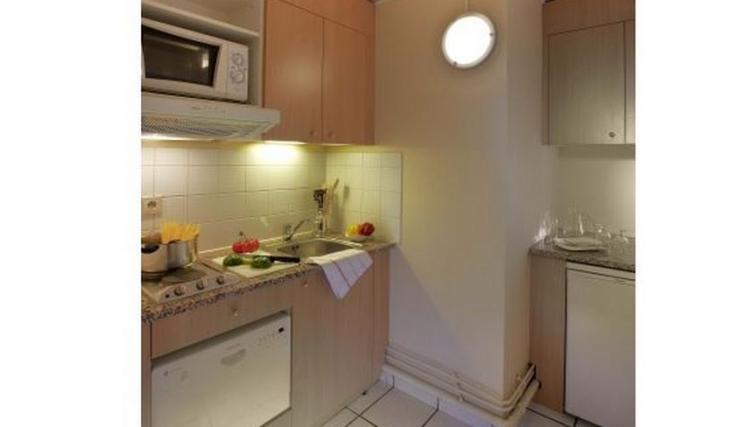 Pristine kitchen in Citadines Wilson Apartments