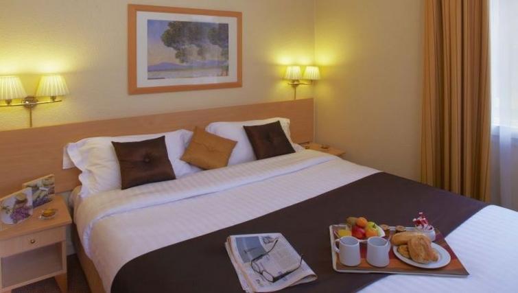 Superior bedroom in Citadines Wilson Apartments