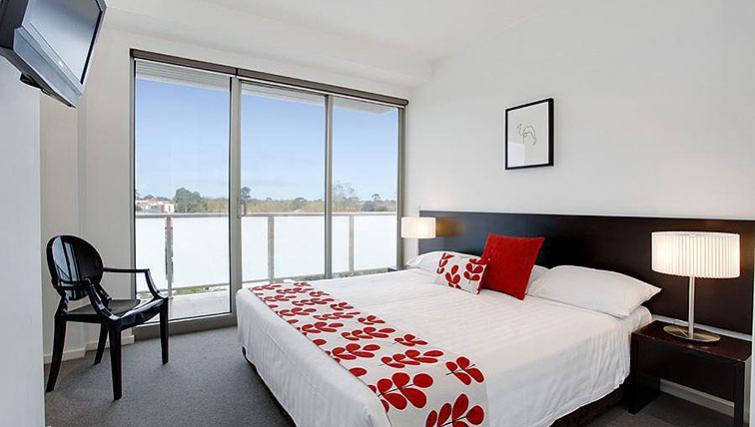 Modern bedroom in Caroline Serviced Apartments