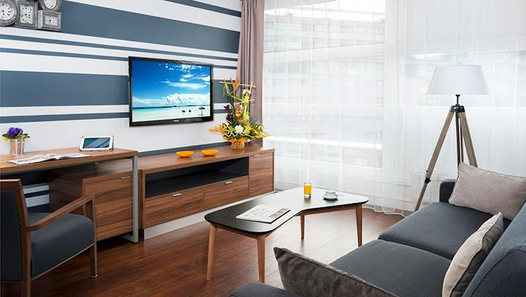 Spacious living area at Citadines Lille Centre Apartments
