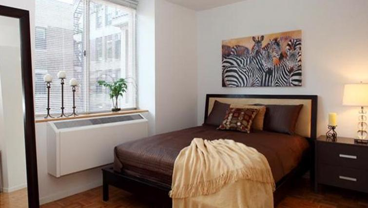Comfortable bedroom in 6th Avenue Apartments