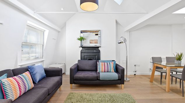 Living area at Berwick Street by Q Apartments