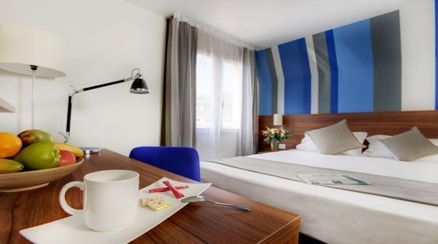 Creative living area in Citadines Grenoble Apartments