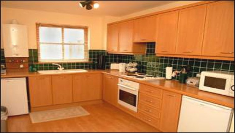 Mature kitchen in The Golf View Apartment