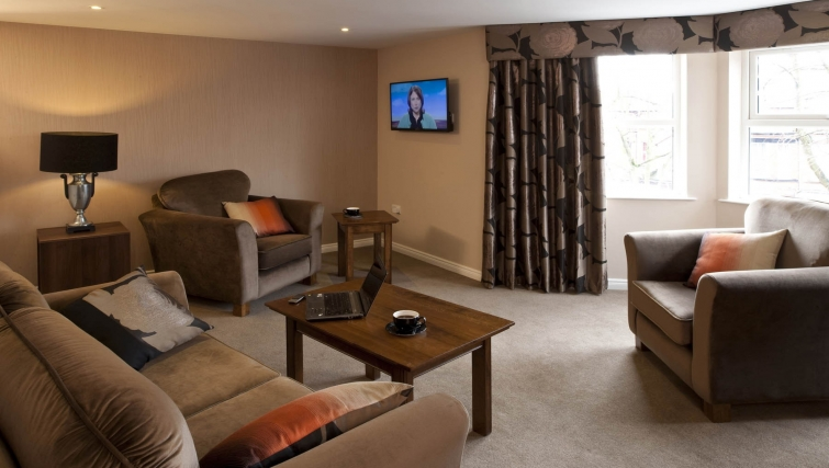Sensational living area in Malone Suite Apartments