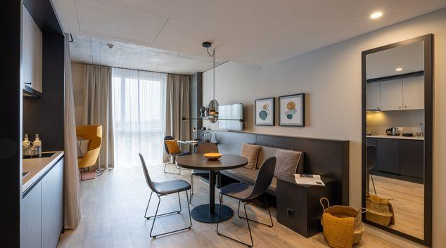 Living area at Joyn Zurich Apartments, Opfikon, Zurich