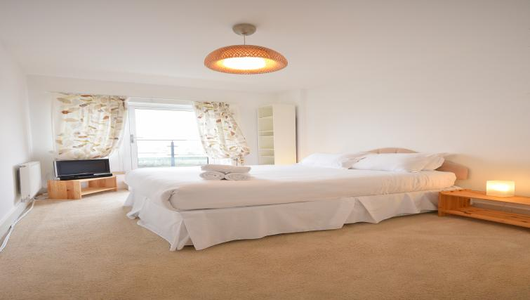 Elegant bedroom in Splash Apartments
