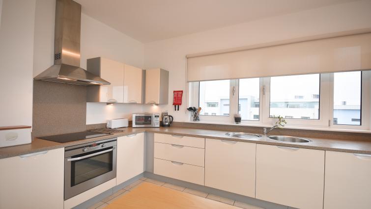 Contemporary kitchen in Splash Apartments