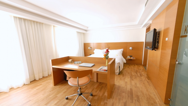 Tasteful bedroom in JM Suites Hotel