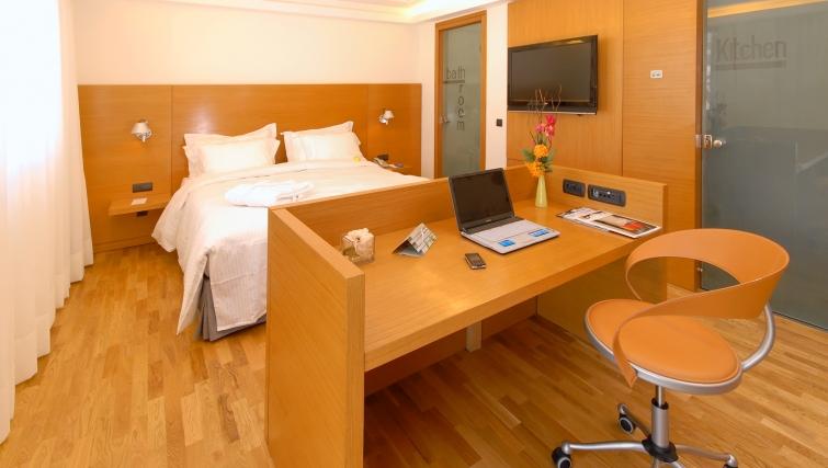 Meticulous bedroom in JM Suites Hotel