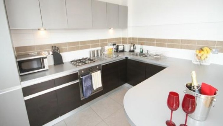 Large kitchen area in Scholars Walk Penthouse Apartment