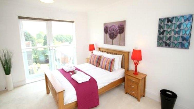 Bright bedroom in Scholars Walk Penthouse Apartment