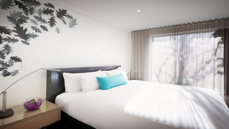 Tidy bedroom in The Como Melbourne Apartments